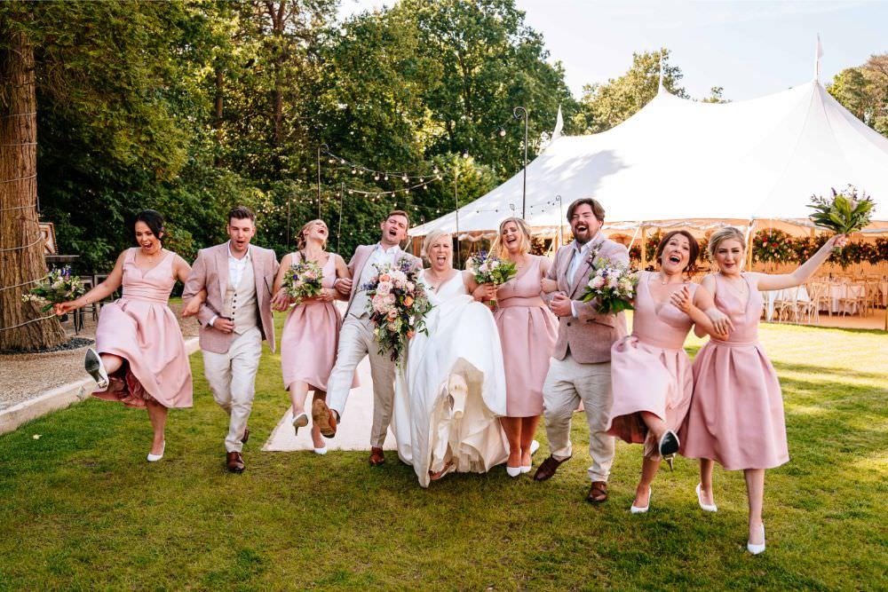 Bride Bridal V Neck Justin Alexander Dress Gown A Line Pink Salmon Custom Suit Groom Bridesmaids Groomsmen Carousel Wedding Sarah Legge Photography