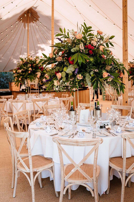 Pedestal Flower Arrangement Table Centres Sperry Tent Carousel Wedding Sarah Legge Photography