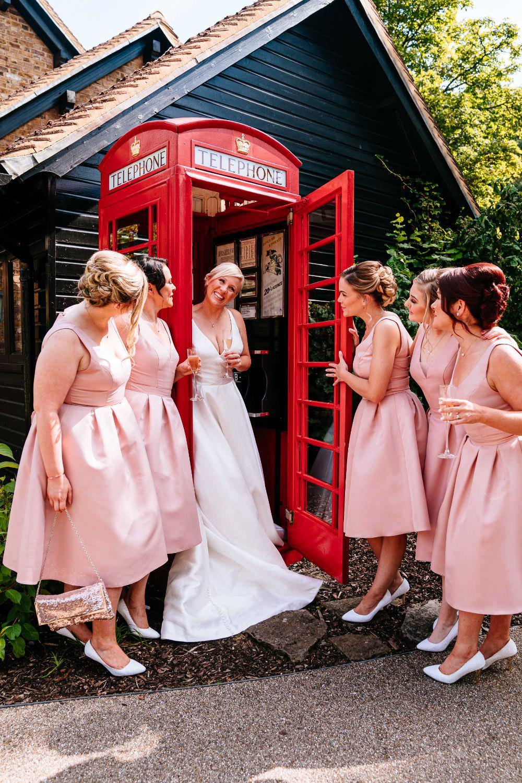 Bride Bridal V Neck Justin Alexander Dress Gown A Line Pink Bridesmaids Telephone Box Guest Book Booth Carousel Wedding Sarah Legge Photography