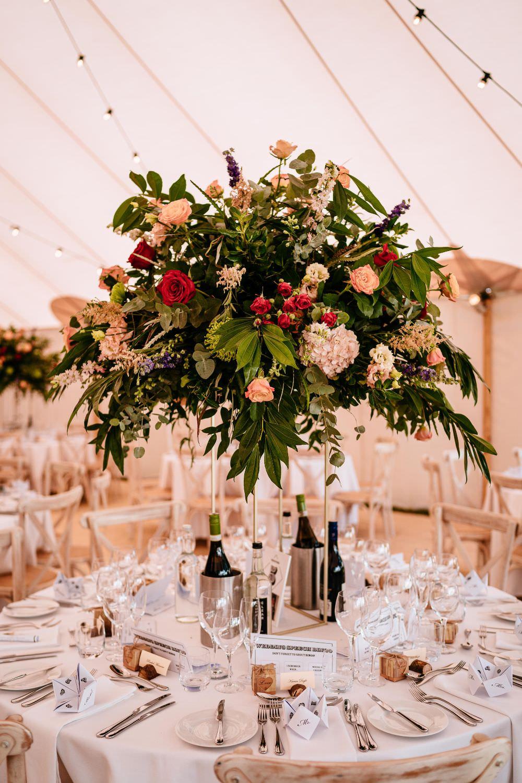 Pedestal Floral Arrangement Flowers Table Centre Festoon Lighting Sperry Tent Carousel Wedding Sarah Legge Photography