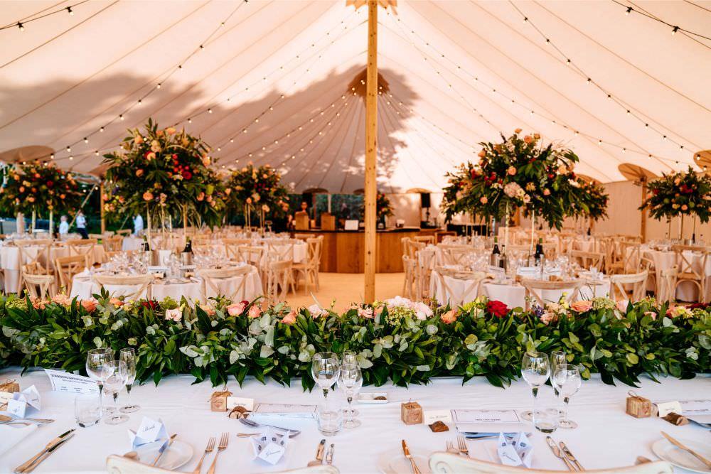 Greenery Runner Sperry Tent Florals Festoon Lighting Top Table Carousel Wedding Sarah Legge Photography