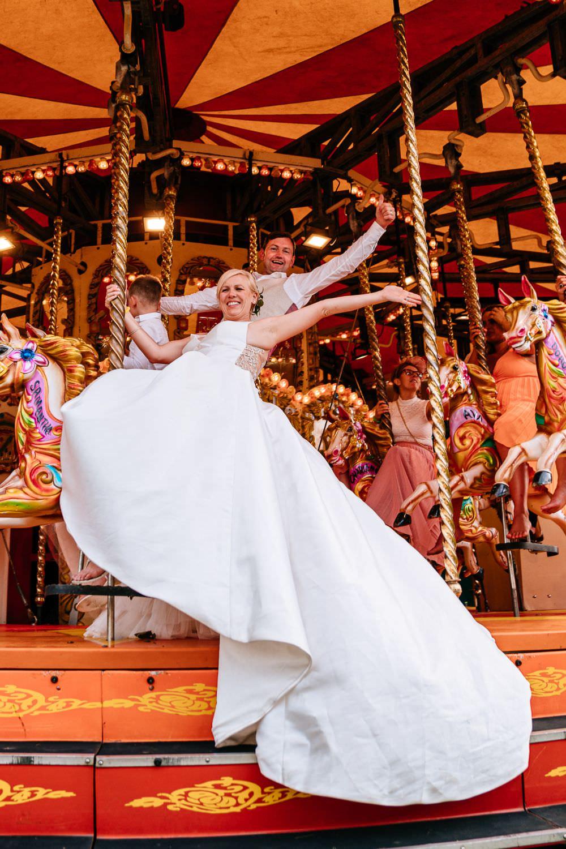 Bride Bridal V Neck Justin Alexander Dress Gown A Line Waistcoat Chinos Custom Suit Groom Carousel Carousel Wedding Sarah Legge Photography