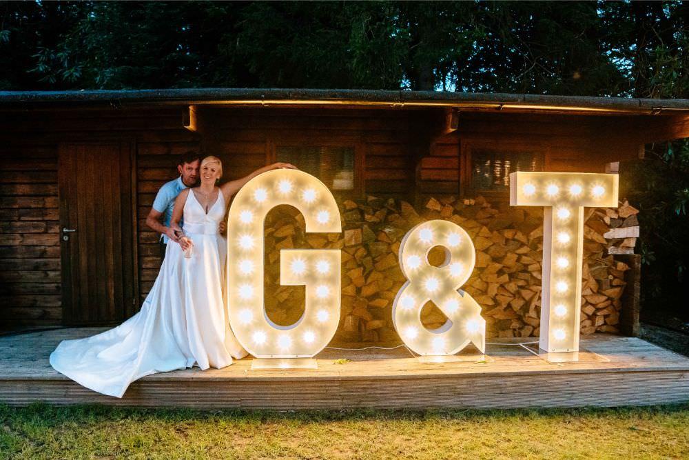 Light Up Letters Initials Bride Bridal V Neck Justin Alexander Dress Gown A Line Waistcoat Groom Carousel Wedding Sarah Legge Photography