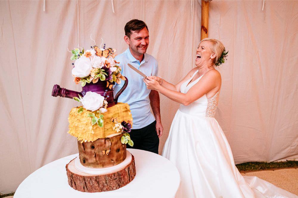 Rustic Cake Wood Slice Cake Cutting Bride Bridal V Neck Justin Alexander Dress Gown A Line Carousel Wedding Sarah Legge Photography