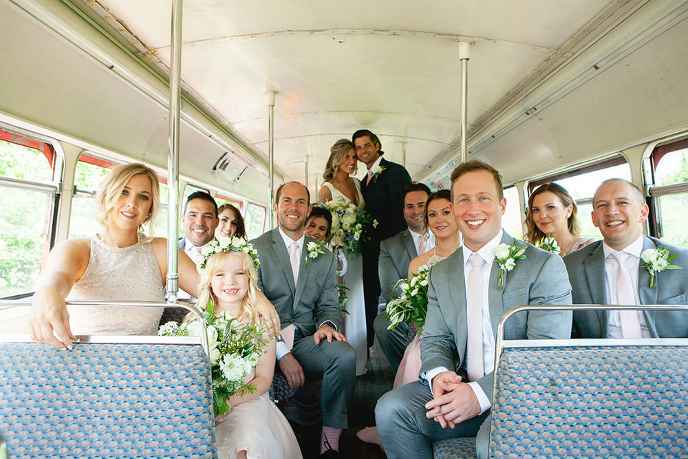 Bride bridal Fitted Fishtail Dress Gown Checked Suit Groom Group Shot Bus Countryside Barn Wedding Katrina Matthews Photography
