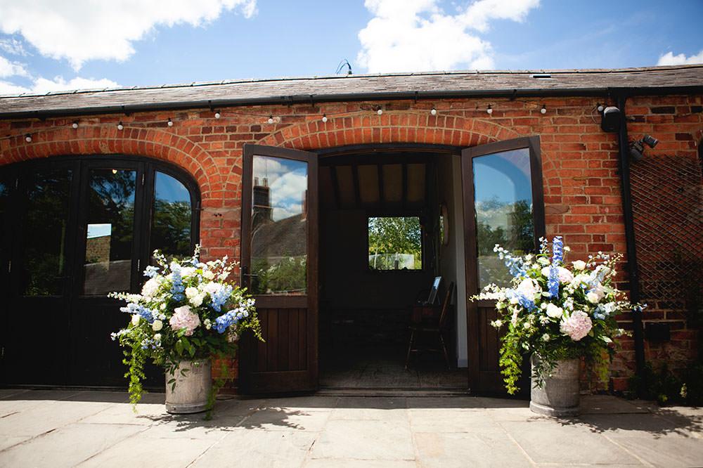 Milk Churns Flowers Floral Stocks Countryside Barn Wedding Katrina Matthews Photography