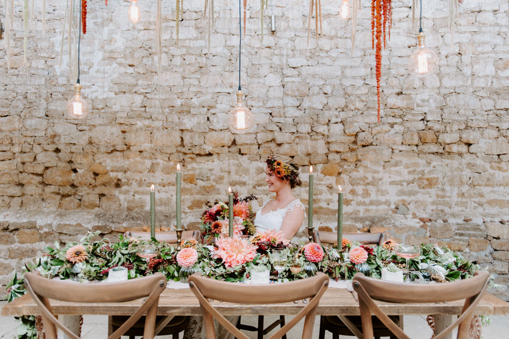 Table Tablescape Decor Decoration Autumn Fall Flowers Wooden Long Candles Dahlia Coral Greenery Suspended Hanging Flowers Foliage Light Bulbs Lighting Ethical Wedding Ideas Sadie Osborne Photography