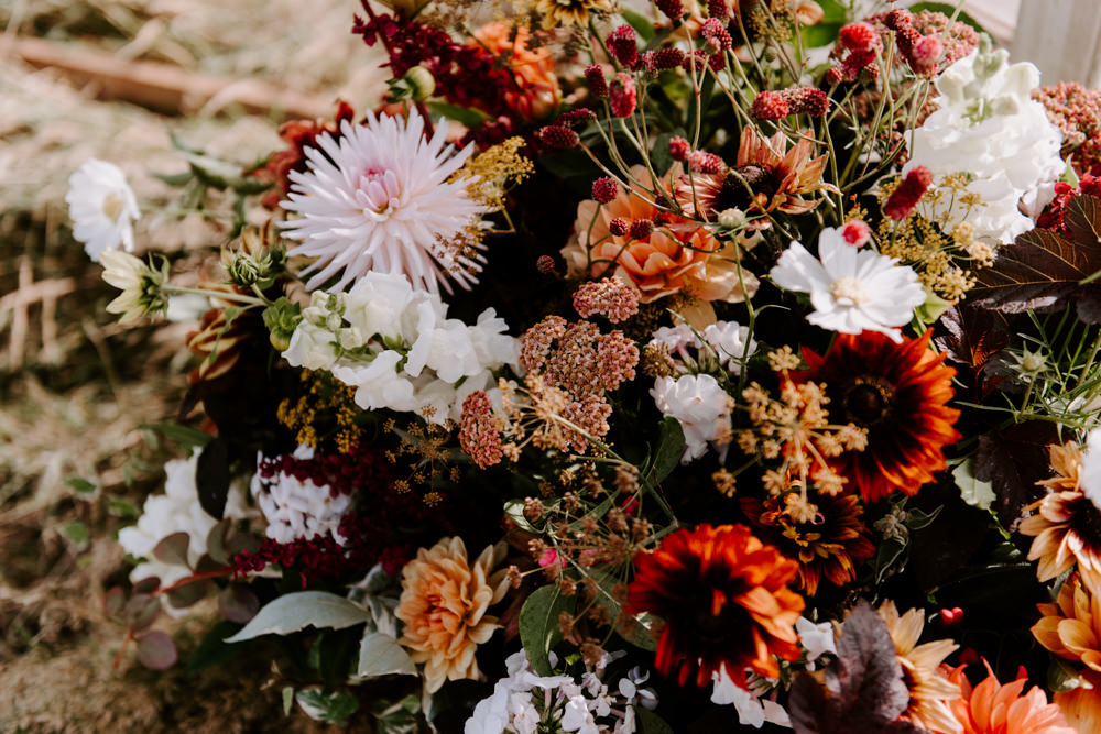 Flowers Flower Arrangement Fall Autumn Coral Pink Greenery Foliage Dahlia Ethical Wedding Ideas Sadie Osborne Photography
