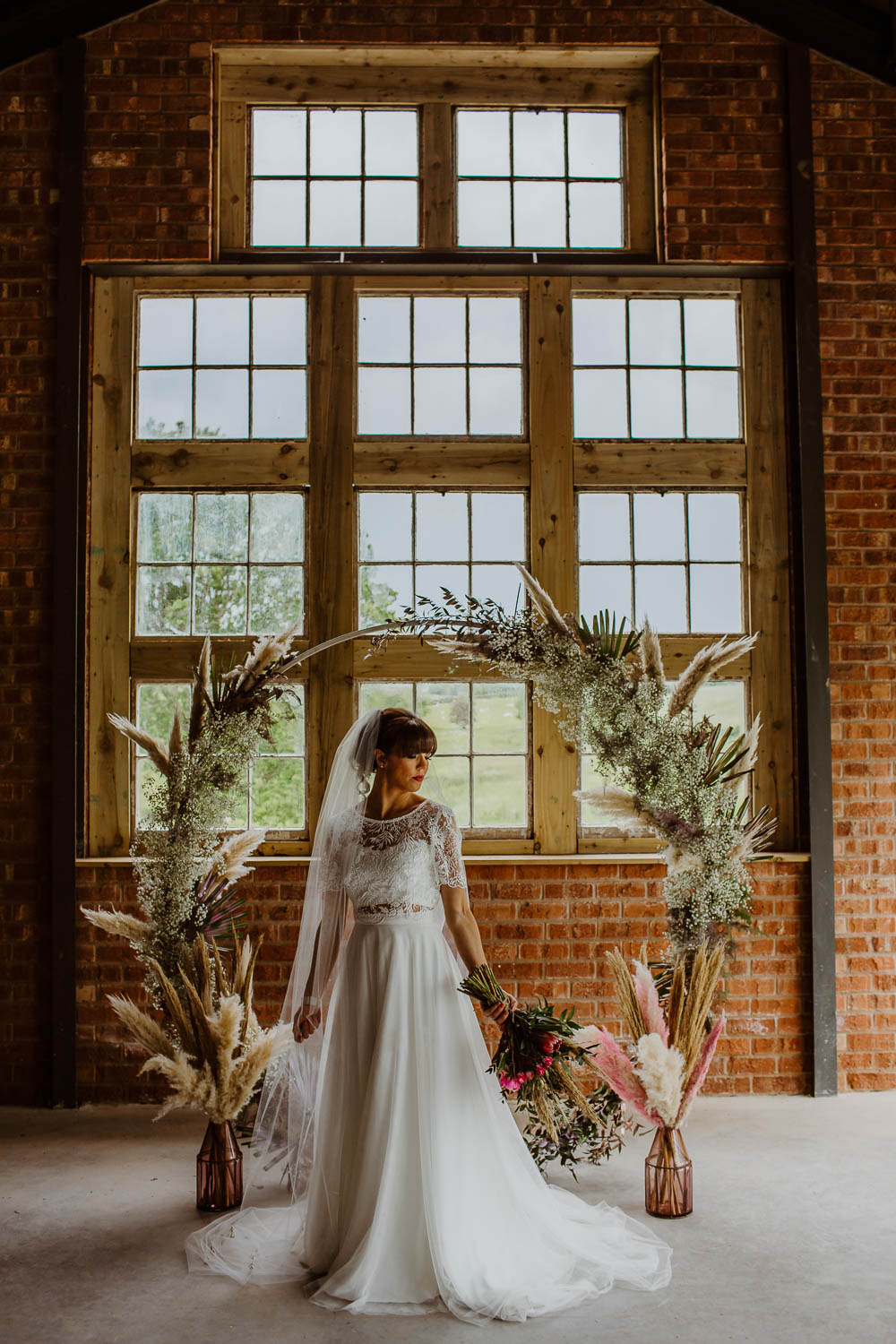 Moon Gate Flower Arch Pampas Grass Backdrop Ceremony Venue Giraffe Shed Wedding When Charlie Met Hannah
