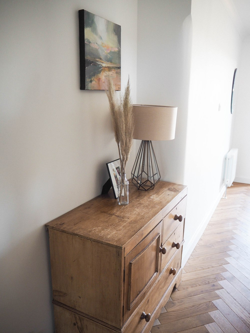 Hallway Renovation 1930s Antique Pine Chest of Drawers Glass Table Lamp Picture Frame Glass Bottle Pampas Grass Art Work Painting