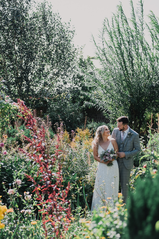 Bride Bridal Strappy Sparkly Sequin V Neck White ASOS Dress Gown Grey Checked Suit Three Piece Waistcoat Groom Hexham Winter Gardens Wedding Leighton Bainbridge Photography