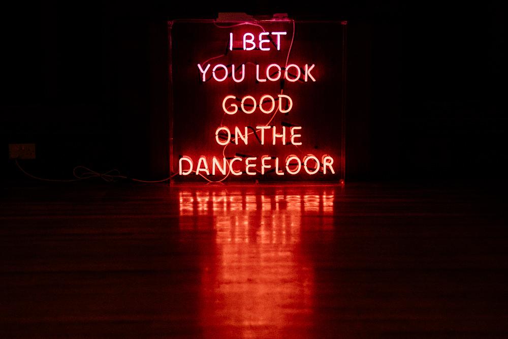 I Bet You Look Good on the Dancefloor Neon Sign Dance Floor Hexham Winter Gardens Wedding Leighton Bainbridge Photography