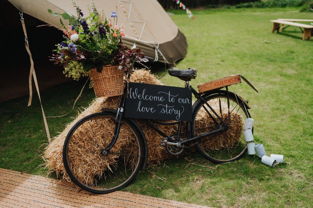 Bike Bicycle Welcome Sign Chalkboard Florals Hay Bale Tipi High Barn Wedding Edenhall Bloom Weddings