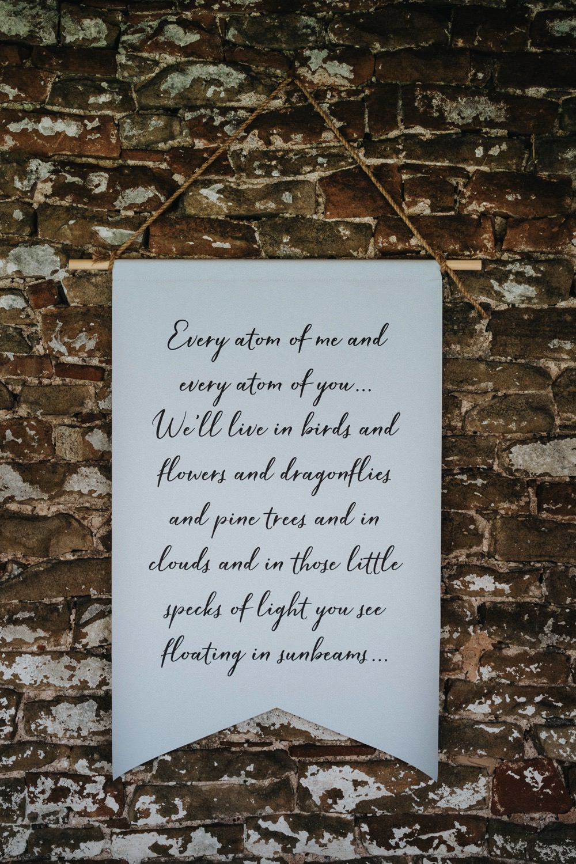 Amber Spyglass Reading Banner Hanging High Barn Wedding Edenhall Bloom Weddings