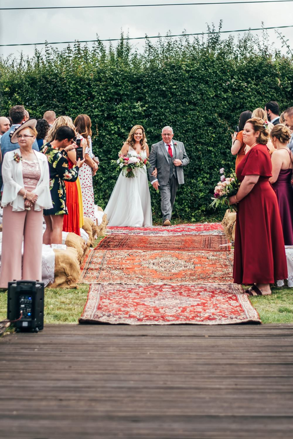 Outdoor Ceremony Persian Rugs Hay Bales Pink Red Wedding Three Flowers Photography