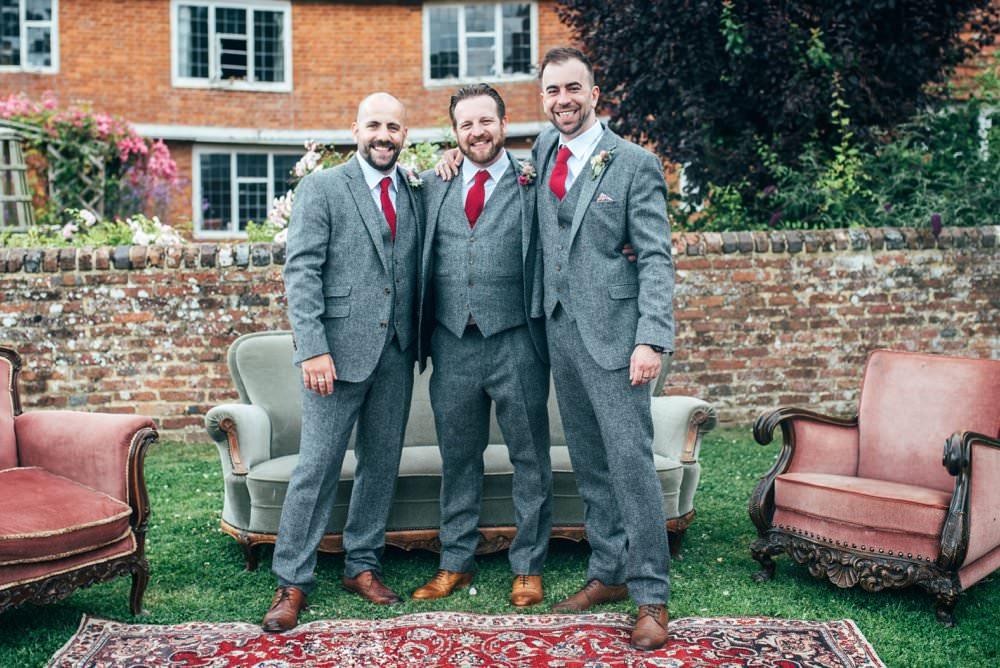 Groom Suit Tweed Grey Tie Groomsmen Pink Red Wedding Three Flowers Photography