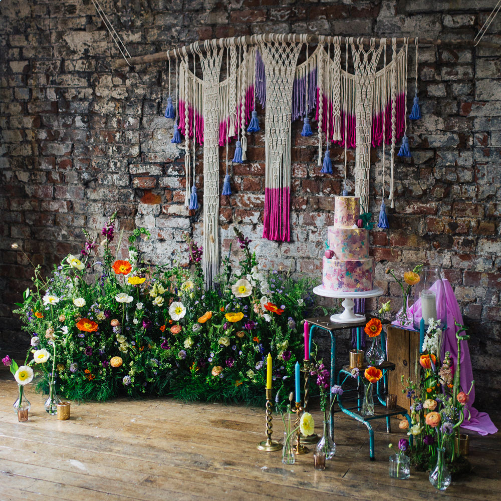Cake Table Meadow Flowers Macrame Backdrop Candles Meadowscape Arrangement Wild Colourful Poppy Poppies Playful Cool Wedding Ideas Sophie Lake Photography