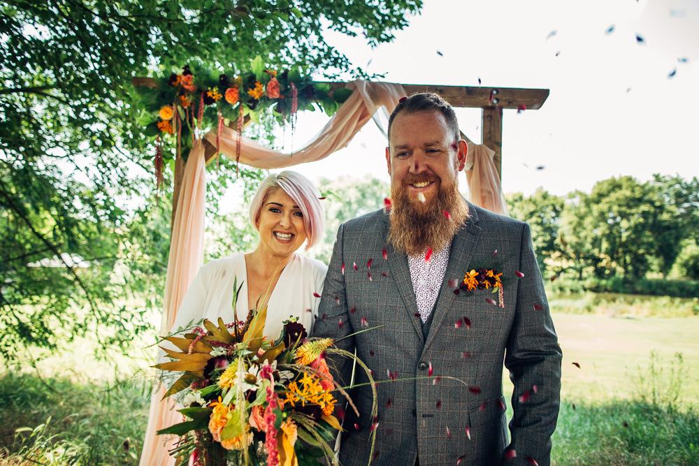 Retro Wedding Ideas Emily Little Wedding Photography Wooden Arbour Backdrop Fabric Drapes Flowers