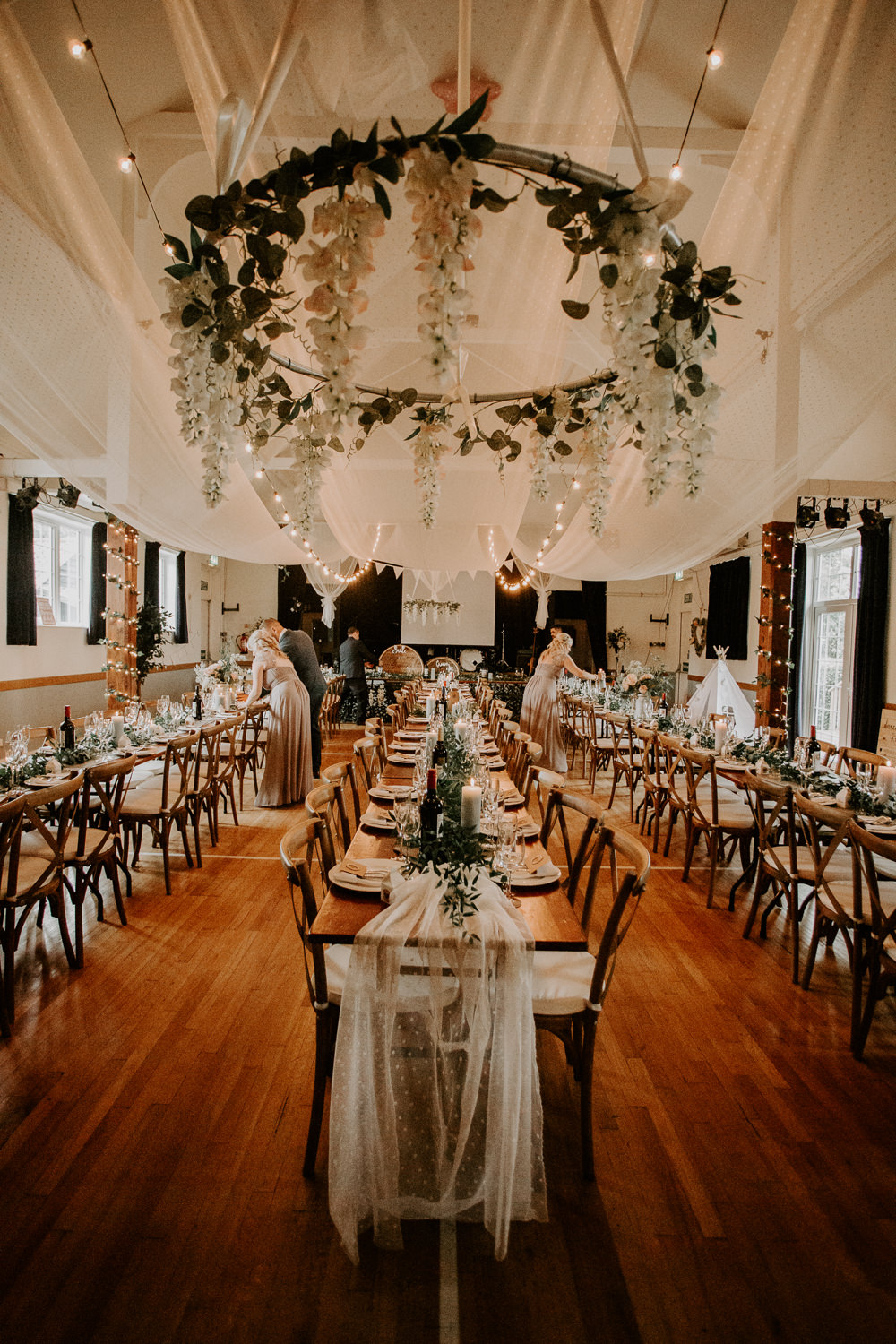 Floral Hoop Hanging Chandelier Draping Ceiling Willingale Village Hall Wedding Photographer Liam Gillan