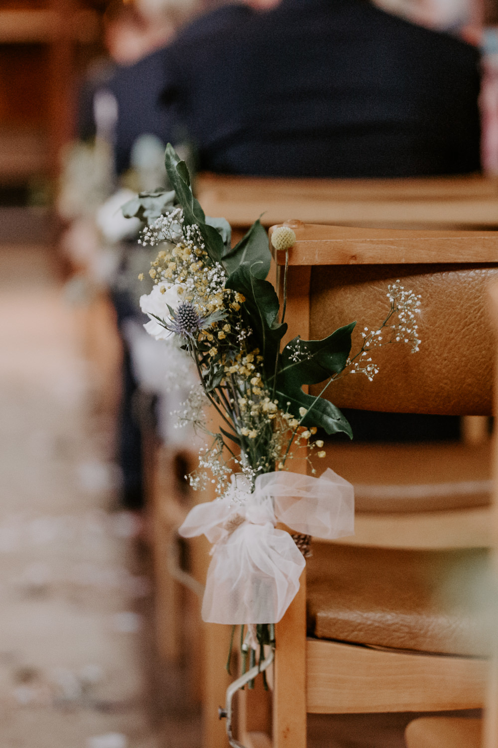 Sea Holly Thistle Greenery Pew Ends Aisle Flowers Willingale Village Hall Wedding Photographer Liam Gillan