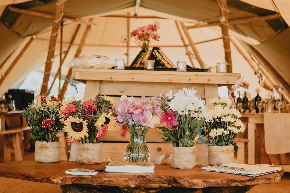 Sweet Pea Sunflower Hessian Flower Troughs Tipi Woodland Tipi Wedding Caroline Goosey Photography