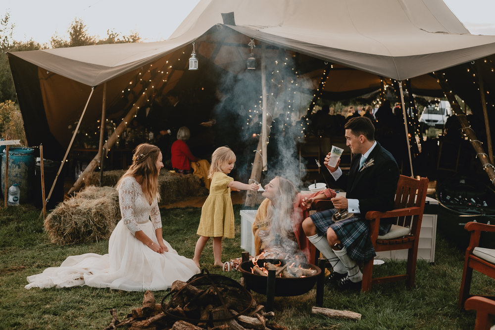 Bride Bridal V Neck Lace Long Sleeve Dress Gown Ribbon Belt Kilt Groom Dried Flower Wheat Bouquet Fire Pit Woodland Tipi Wedding Caroline Goosey Photography
