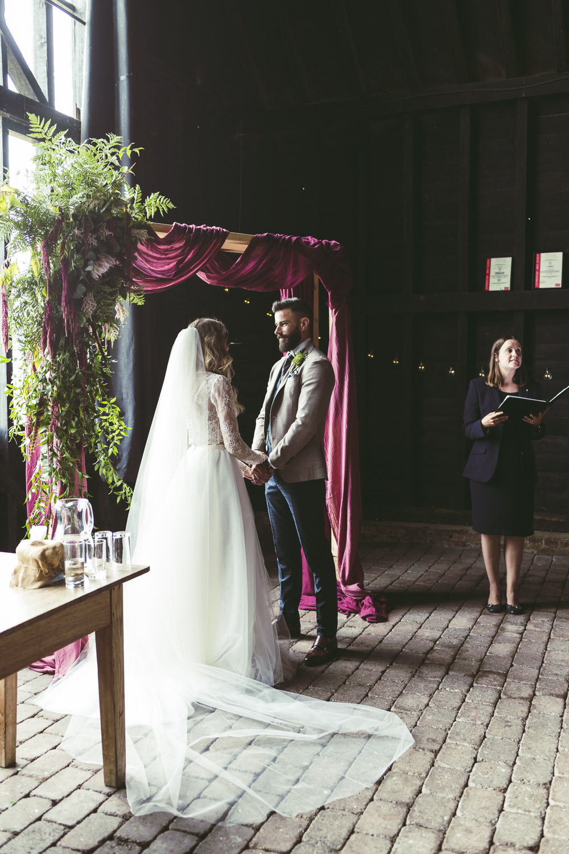 Ceremony Backdrop Flower Arch Fabric Greenery Foliage Aisle Kingshill Barn Wedding Sandra Reddin Photography
