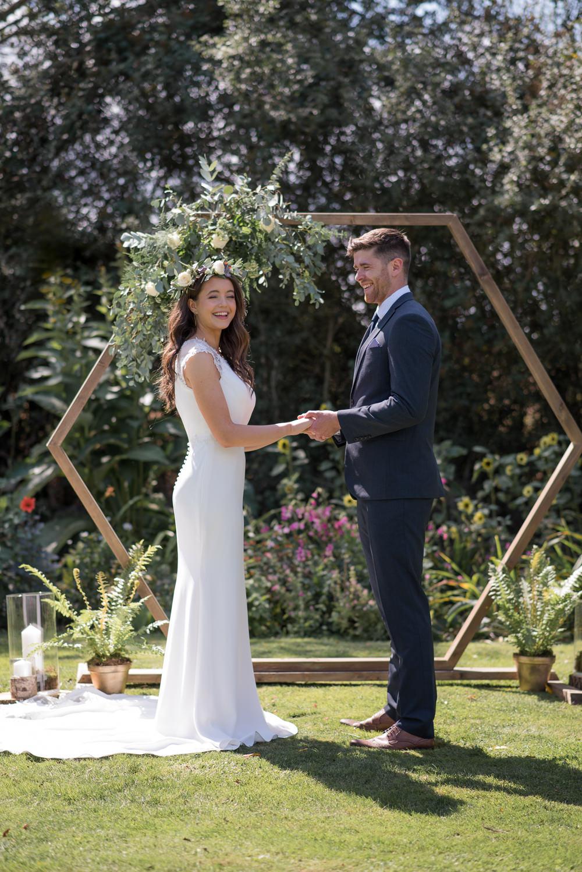 Geometric Backdrop Greenery Foliage Flowers Arch Ceremony Aisle Hexagon Minimalist Wedding Ideas Nicola Belson Photography