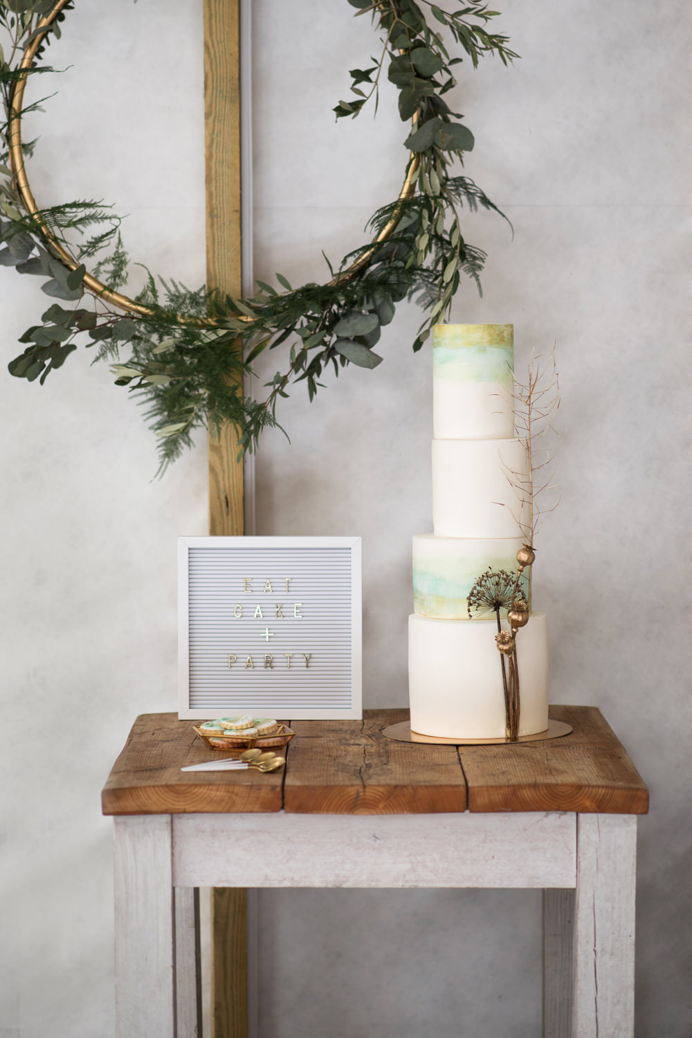 Cake Iced Tall Green Gold Painted Watercolour Flower Heads Wreath Table Felt Peg Board Sign Signage Signs Minimalist Wedding Ideas Nicola Belson Photography