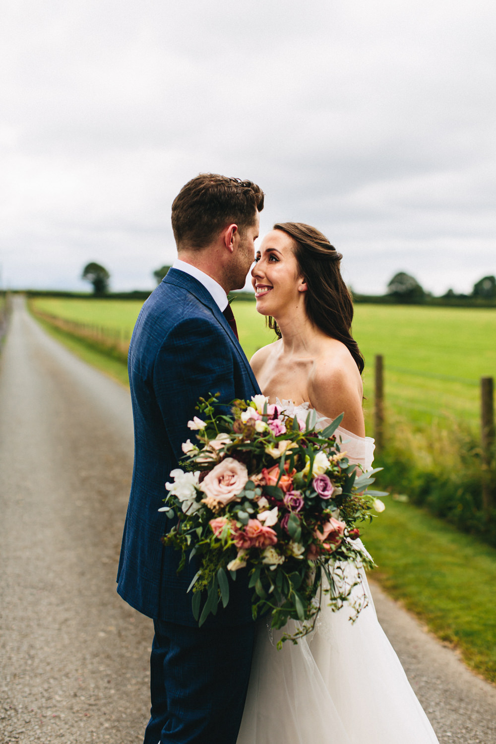 Bouquet Flowers Bride Bridal Greenery Foliage Sweetpeas Freesias Peony Rose Burgundy Pink Outbuildings Wedding Jessica O'Shaughnessy Photography