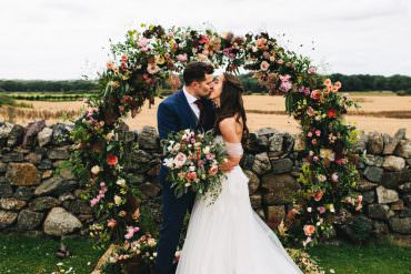 Floral & Rural Tipi Wedding with a Moon Gate Flower Arch