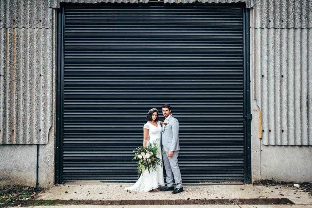Grey Suit Groom Pink Tie Tuffon Hall Wedding Three Flowers Photography