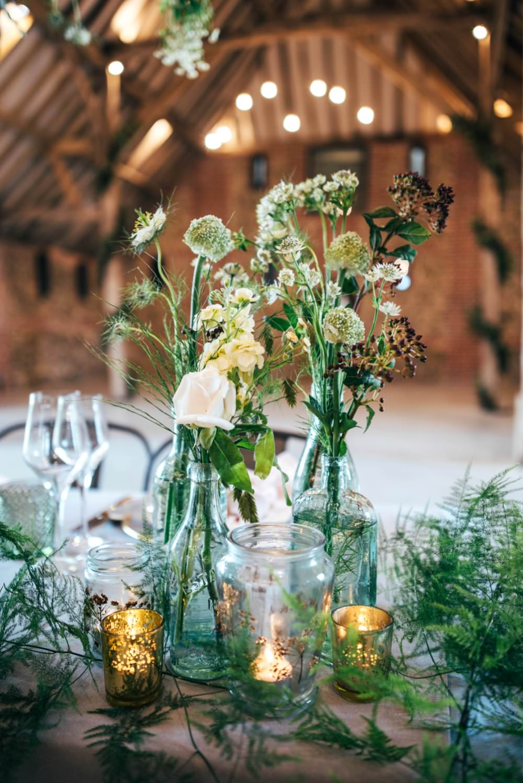 Bottle Flowers Centrepiece Decor Foliage Greenery Candles Tuffon Hall Wedding Three Flowers Photography