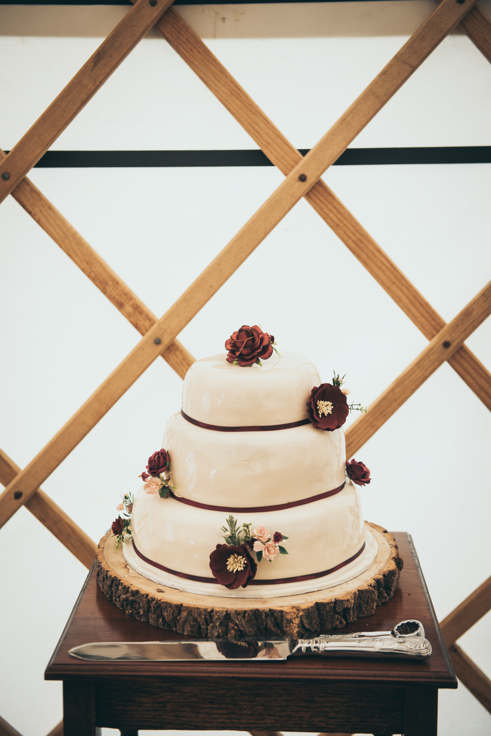 Iced Cake Burgundy Flowers Log Stand Fron Farm Yurt Retreat Wedding Cat Arwel Photography