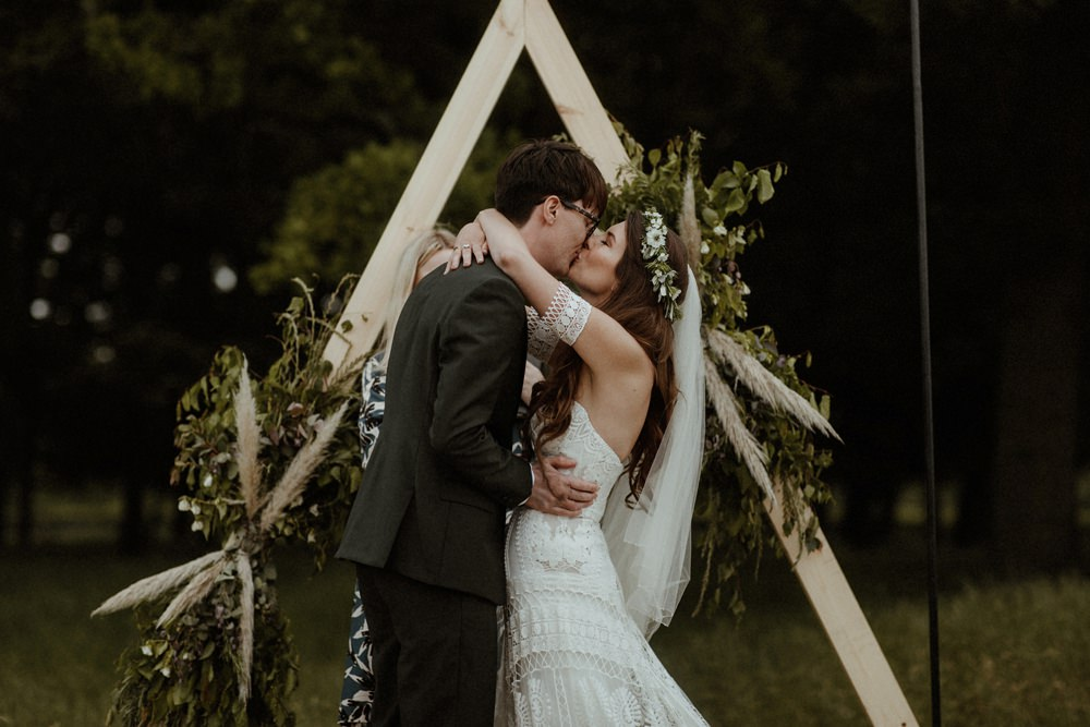 Backdrop Triangle Flowers Festoon Lights Backdrop Ceremony Outdoor Wedding UK Olivia and Dan Photography
