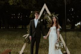 Backdrop Triangle Flowers Festoon Lights Backdrop Ceremony Outdoor Wedding UK Olivia and Dan Photography