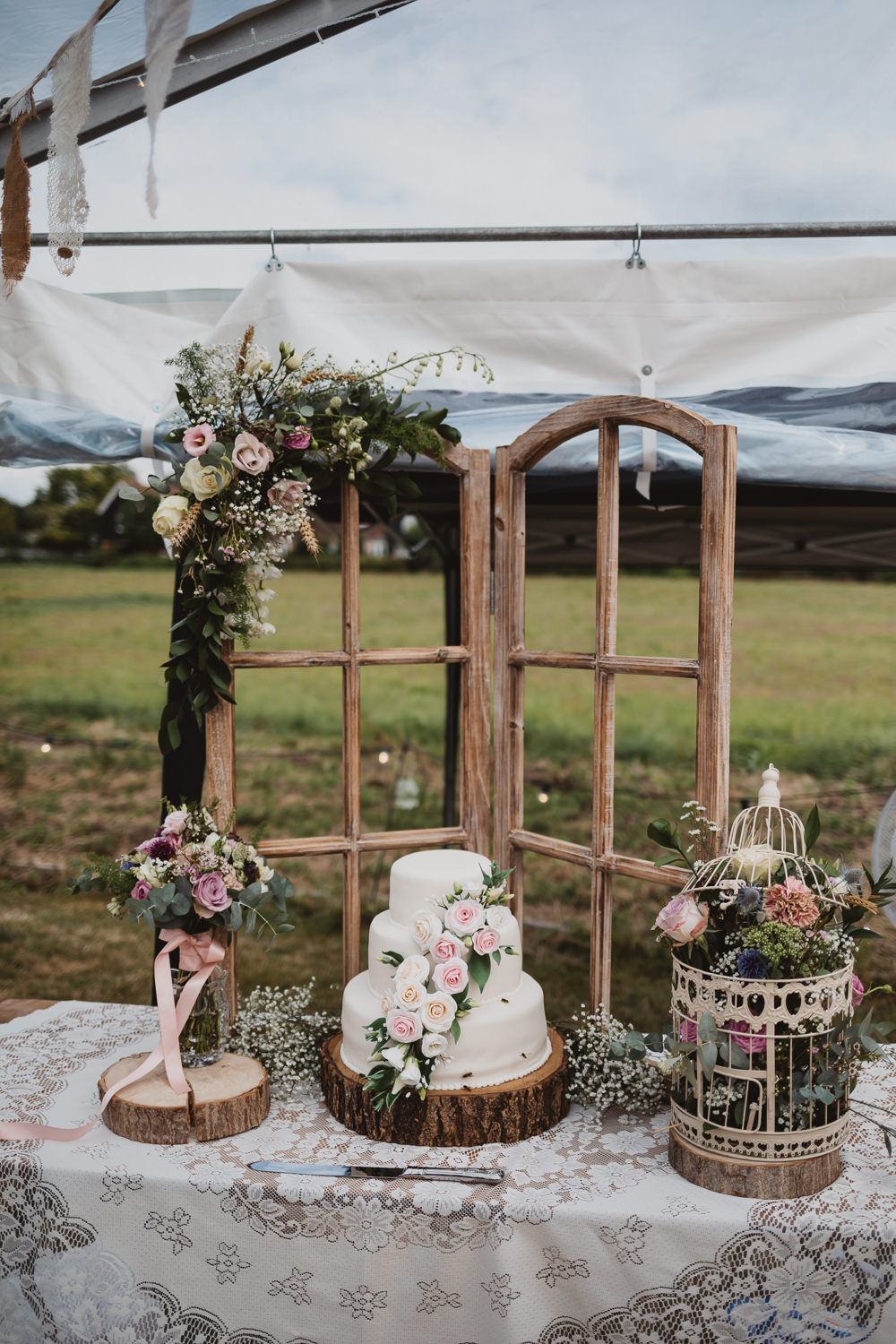 Iced Cake Sugar Flowers Log Slice Stand Table Wooden Windo Frame Flowers Clear Marquee Wedding Sarah Brookes Photography