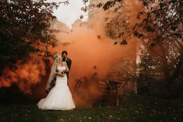 Dark & Moody Halloween Wedding Featuring Pumpkins & Smoke Bombs