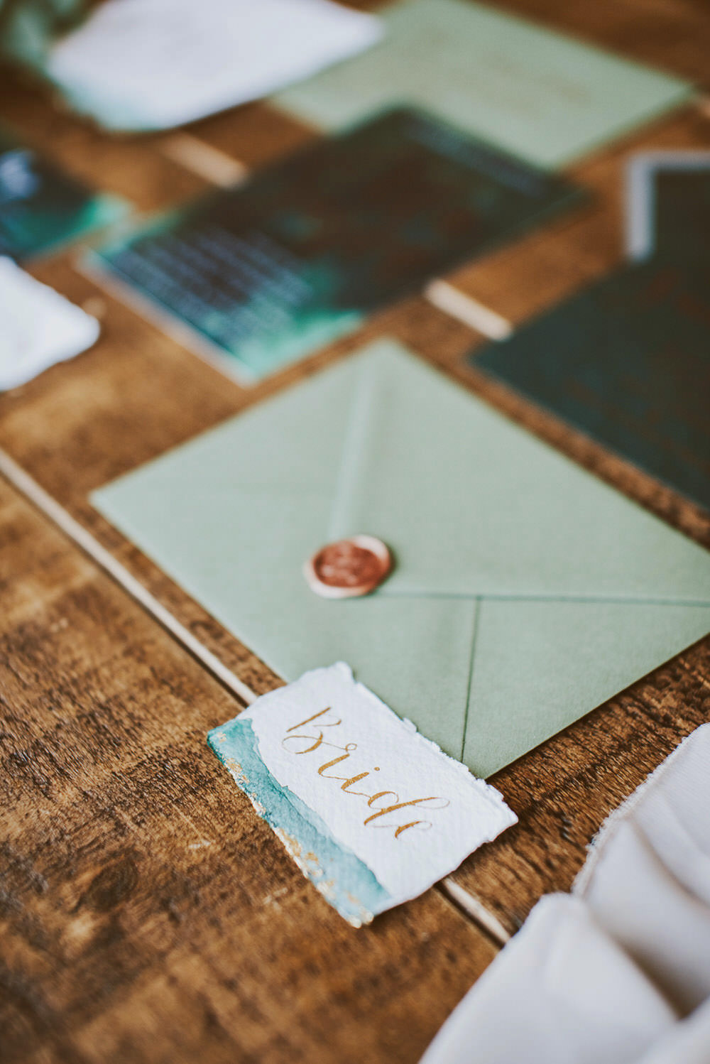 Stationery Suite Invitations Invite Flat Lay Calligraphy Wax Seal Envelope Green Gold Wedding Ideas Samantha Davis Photography