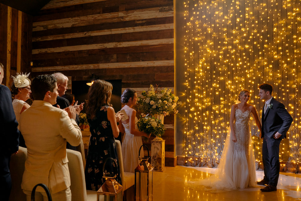 Fariy Lights Backdrop Ceremony Industrial Barn Wedding Toast Of Leeds