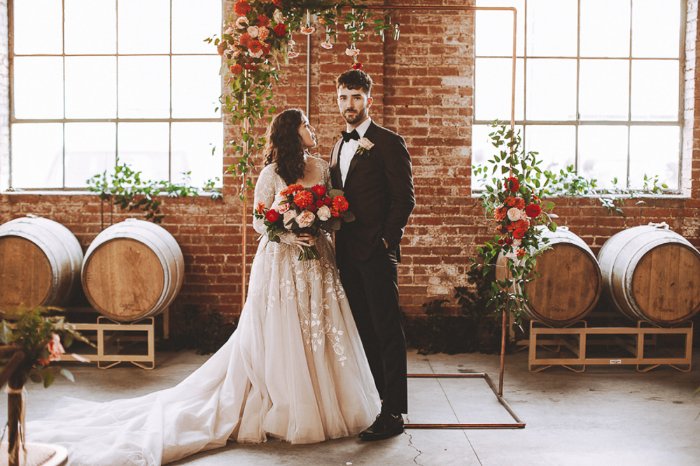 Industrial Distillery Wedding Nessa K Photography Flower Arch Metal Copper Backdrop