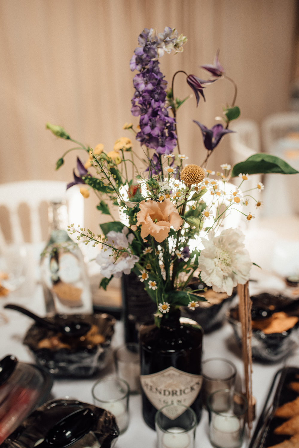 Table Flowers Centrepiece Gin Bottle Lineham Farm Wedding Marni V Photography