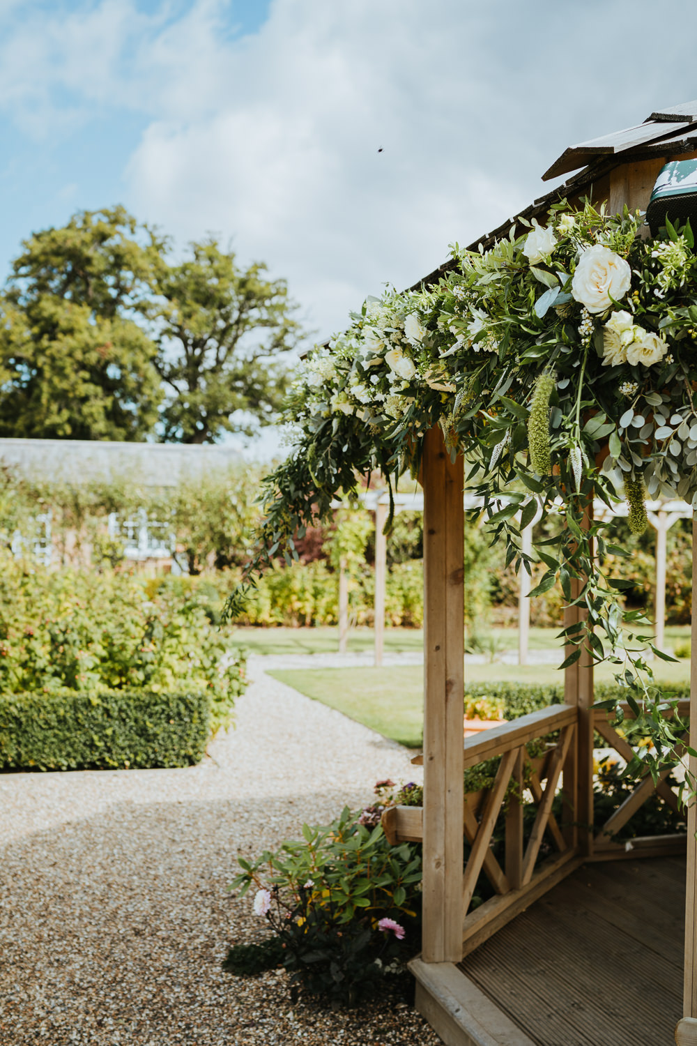 Secret Garden Kent Outdoor Ceremony Gazeebo Pagoda Flowers Greenery Foliage Micro Wedding Nicola Dawson Photography