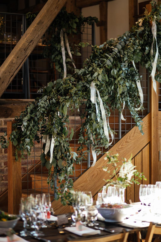 Flowers Rose Eucalyptus Greenery Foliage Stairs Staircase Ribbons Oak Barn Wedding Matilda Delves Photography