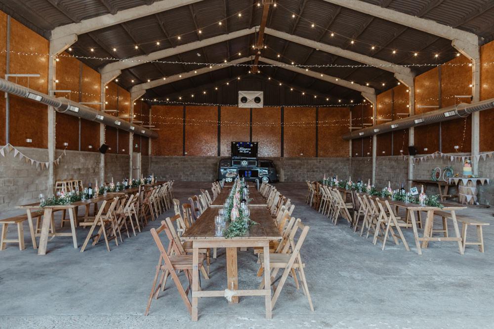 Long Wooden Trestle Tables Chairs Festoon Lights Lighting Barns Lodge Farm Wedding Stevie Jay Photography