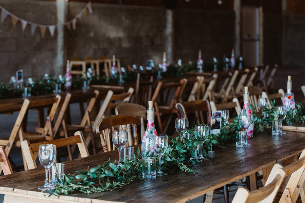 Long Wooden Trestle Tables Chairs Festoon Lights Lighting Greenery Barns Lodge Farm Wedding Stevie Jay Photography