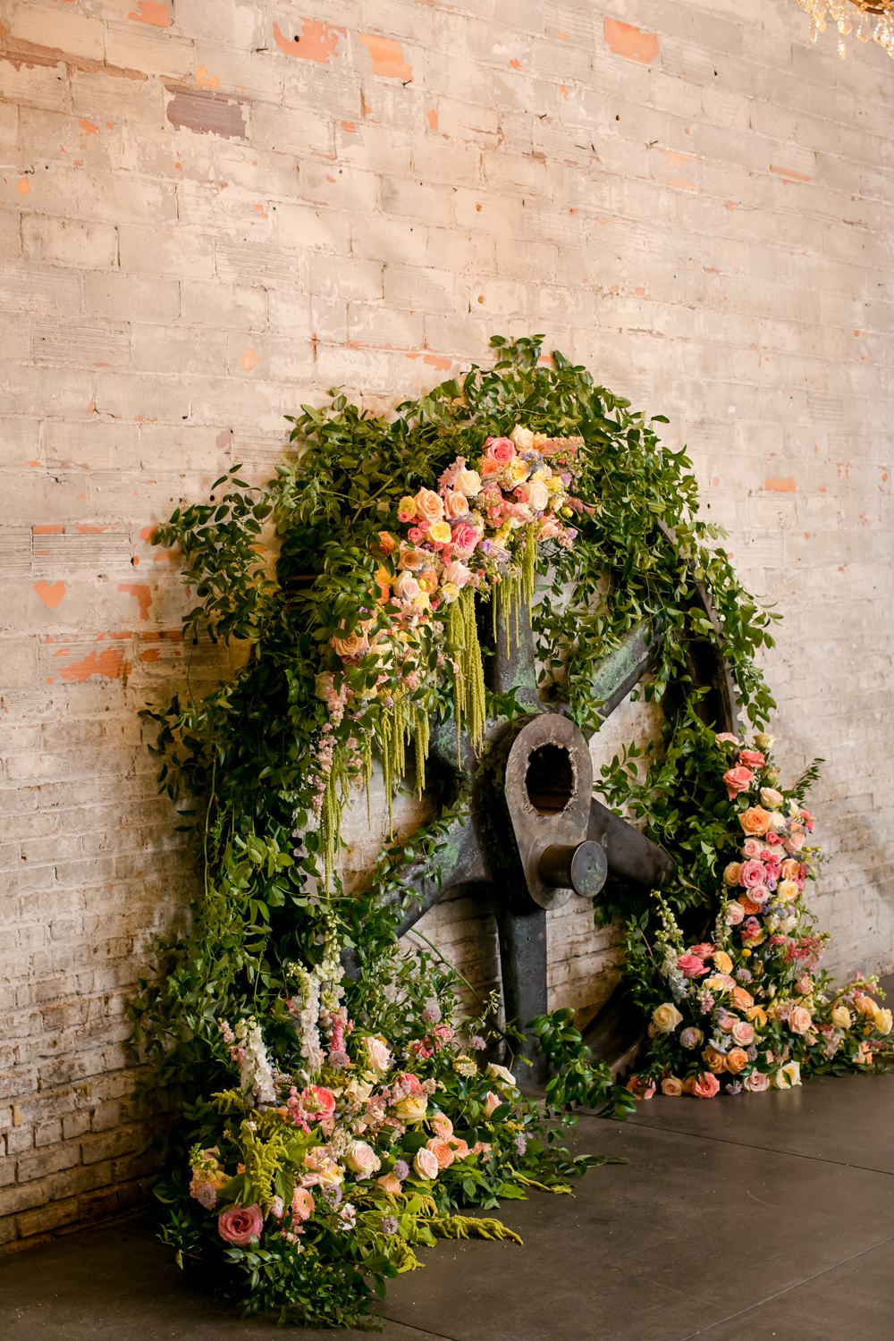 Wooden Wheel Flowers Backdrop Greenery Foliage Peony Rose Floral Minneapolis Wedding Jeannine Marie Photography