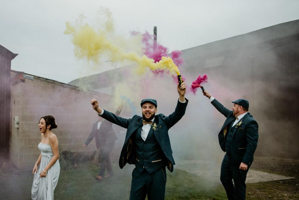 Groom Groomsmen Suit Tweed Bow Tie Flat Caps Fun Barn Wedding Kazooieloki Photography Smoke Bomb Photo Portrait Photographs