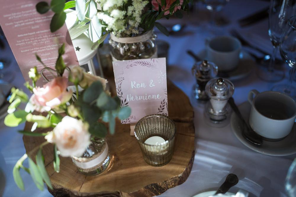Centrepiece Flowers Table Names Log Slice Harry Potter Haughley Park Barn Wedding Him and Her Wedding Photography