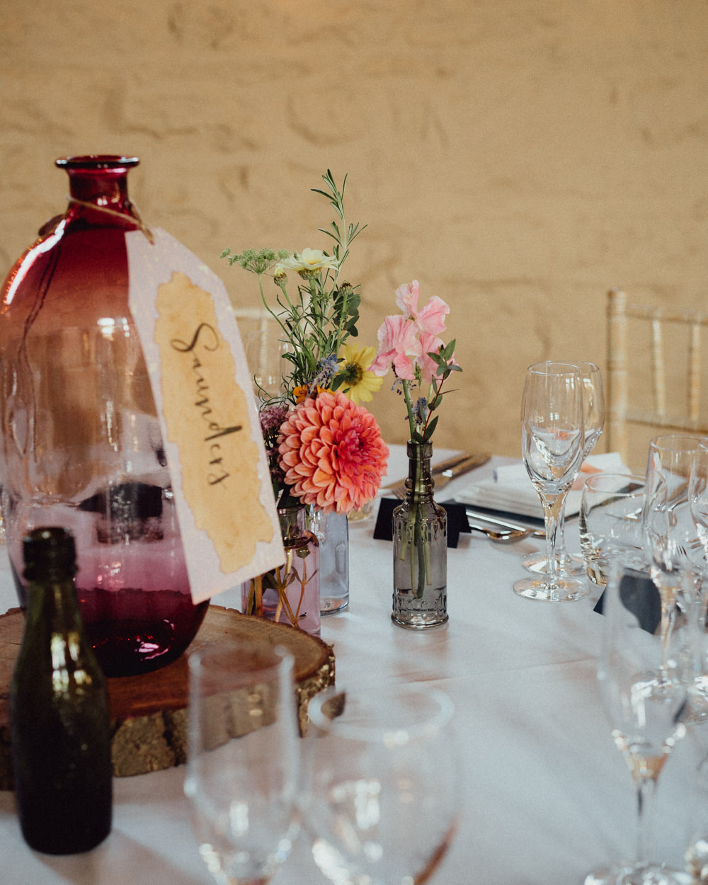 Centrepiece Table Flowers Bottle Table Name Log Slice Priors Court Barn Wedding Emily & Steve Photography